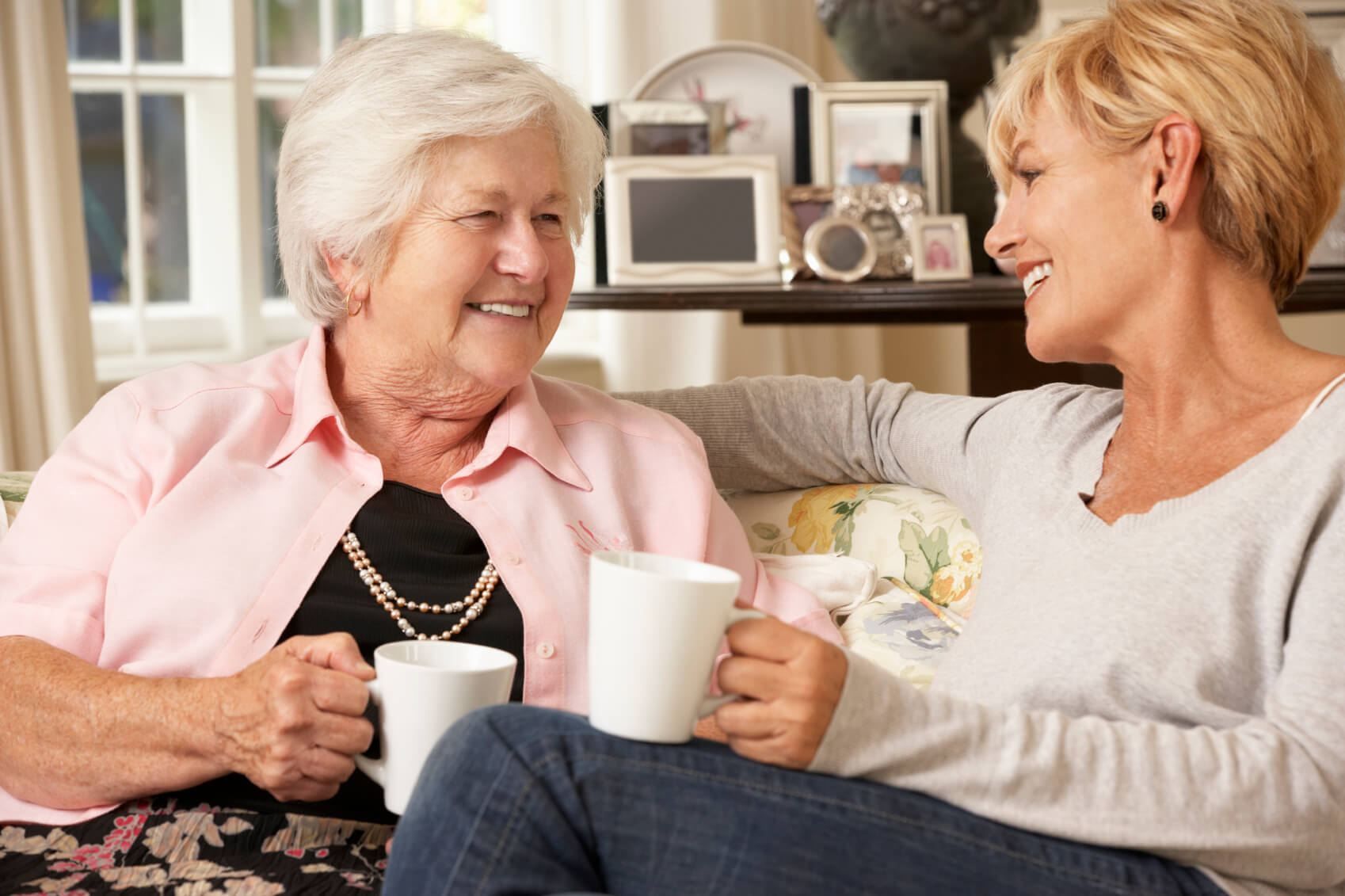 After respite care services, mom and daughter are enjoying tea together.